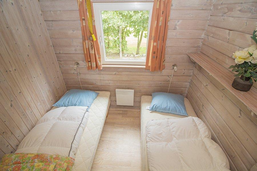 Eines der Schlafzimmer mit Einzelbetten.