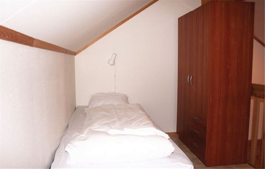Einzelbett im oberen Schlafzimmer