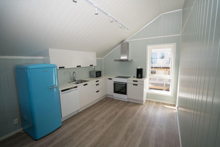 Voll ausgestattete Küche in Apartment A-H.