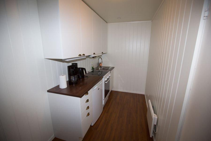 Voll ausgestattete Küchenzeile in einem der Apartments.