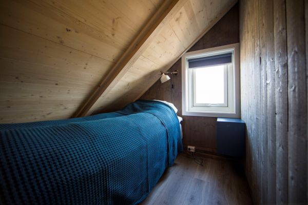 Schlafzimmer im Obergeschoss. Foto: jennyhoff.no