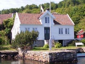 Ferienhaus Malakka liegt traumhaft in einer geschützen Bucht vor Farsund. Norwegische Idylle pur!