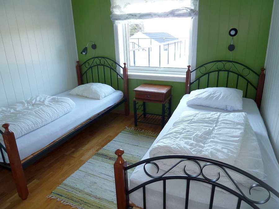 Eines der zwei Schlafzimmer mit jeweils 2 Einzelbetten  in  der Wohnung Beate-1-Obergeschoß