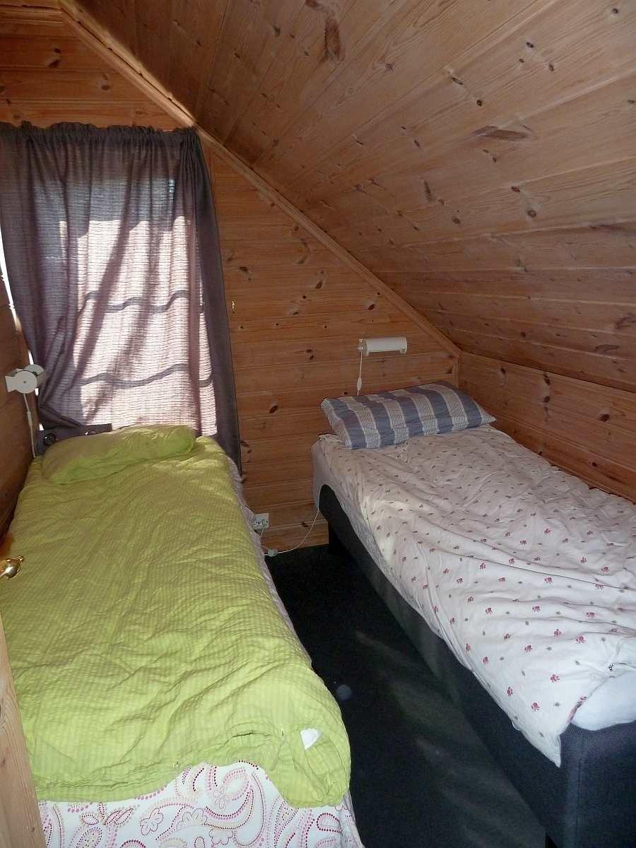 Das zweite Schlafzimmer mit zwei Einzelbetten - auch hier können die Betten bei Bedarf zum Doppelbett zusammengeschoben werden