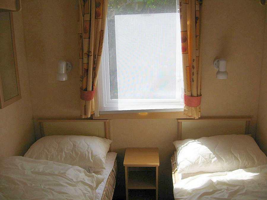 Das Schlafzimmer mit 2 Einzelbetten im Haus 6