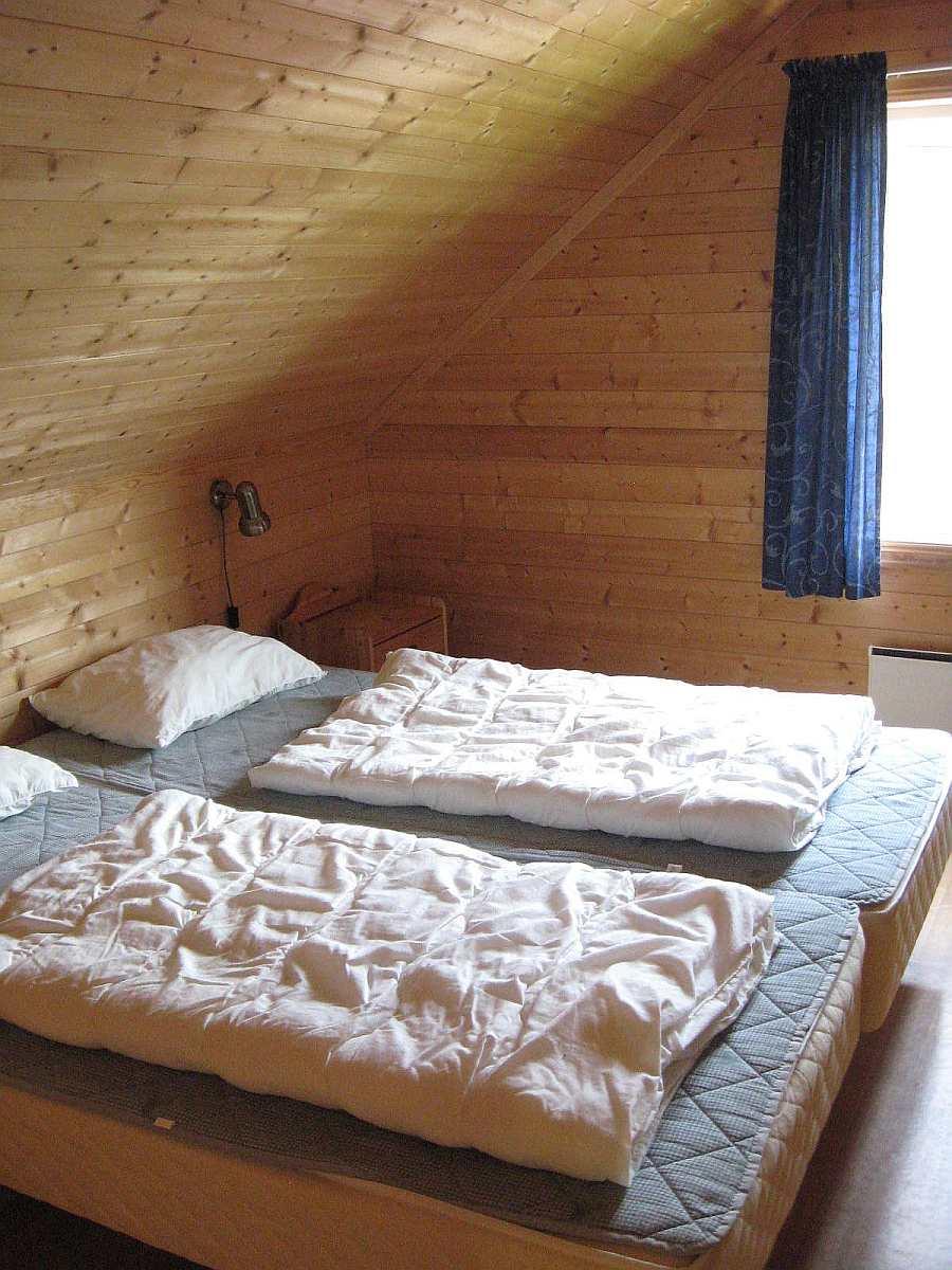 Eines der 4 Schlafzimmer mit je zwei Einzelbetten in den Ferienhäusern 3 oder 4 - zusammengeschoben können die Betten als Doppelbett genutzt werden.