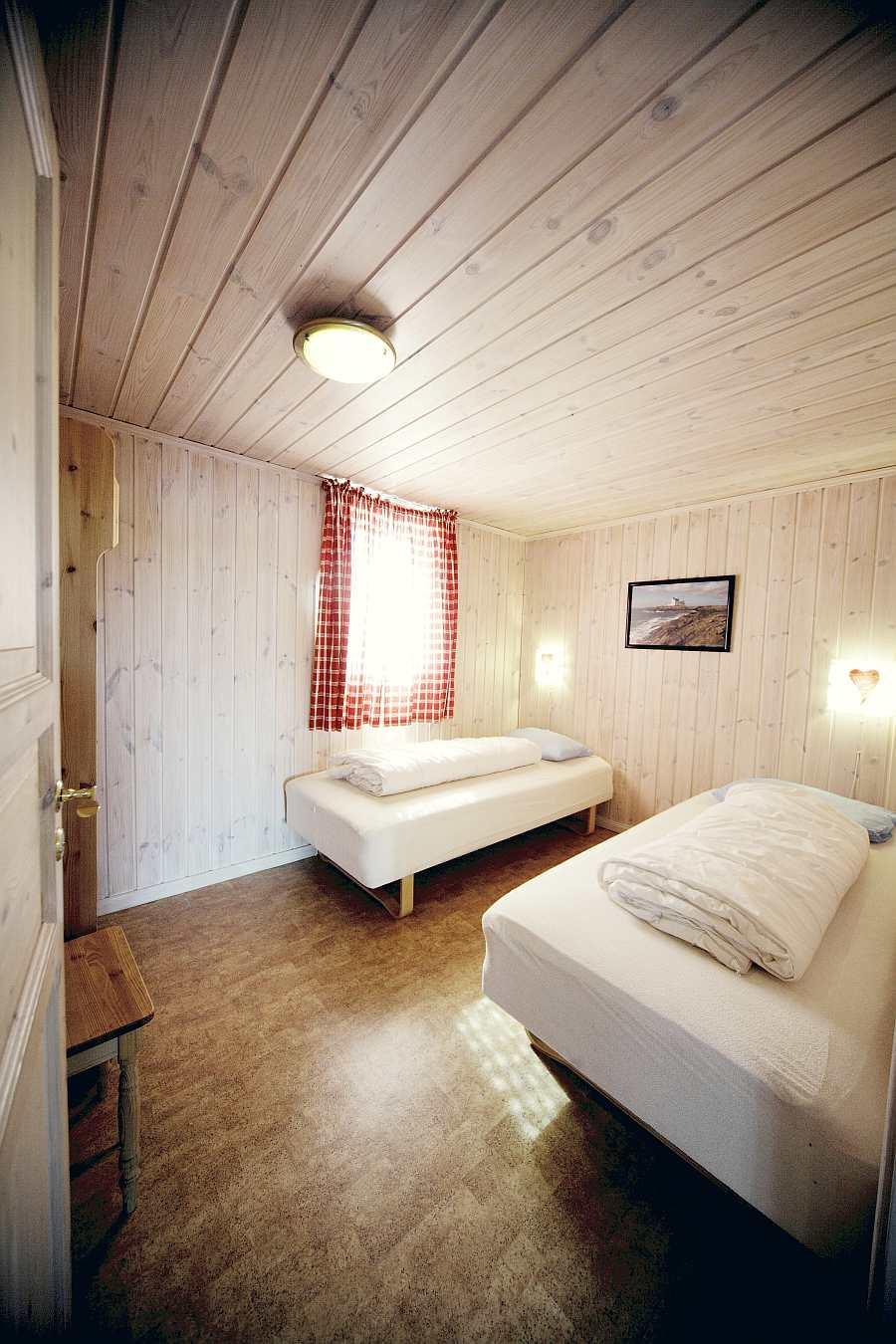 Eines der  6 Schlafzimmer des Ferienhauses Fjorstua