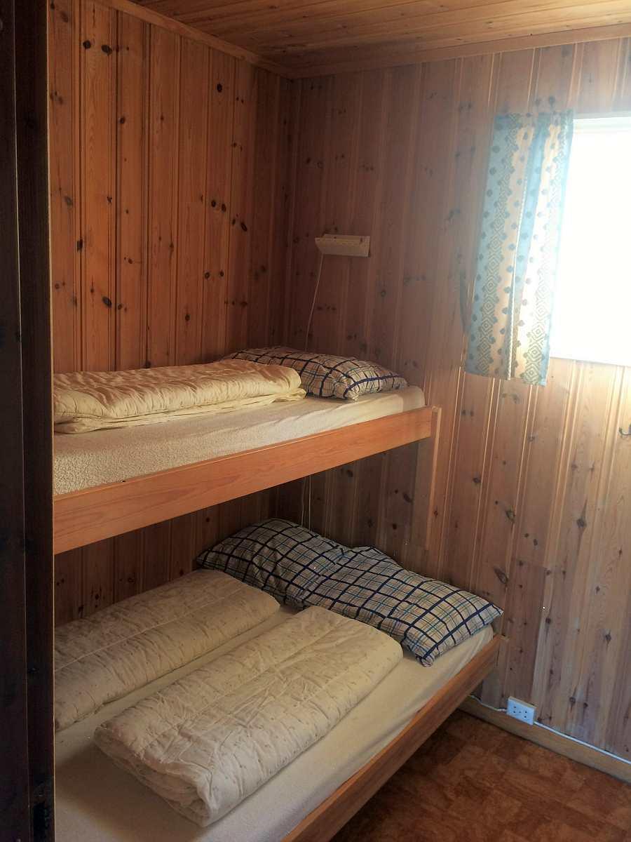 Eines der drei Schlafzimmer im Ferienhaus Typ A