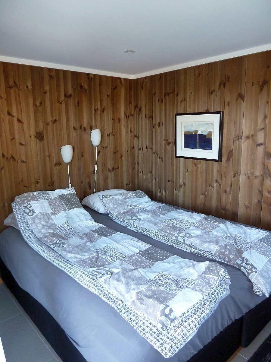 Das Schlafzimmer mit einem Doppelbett im Annex