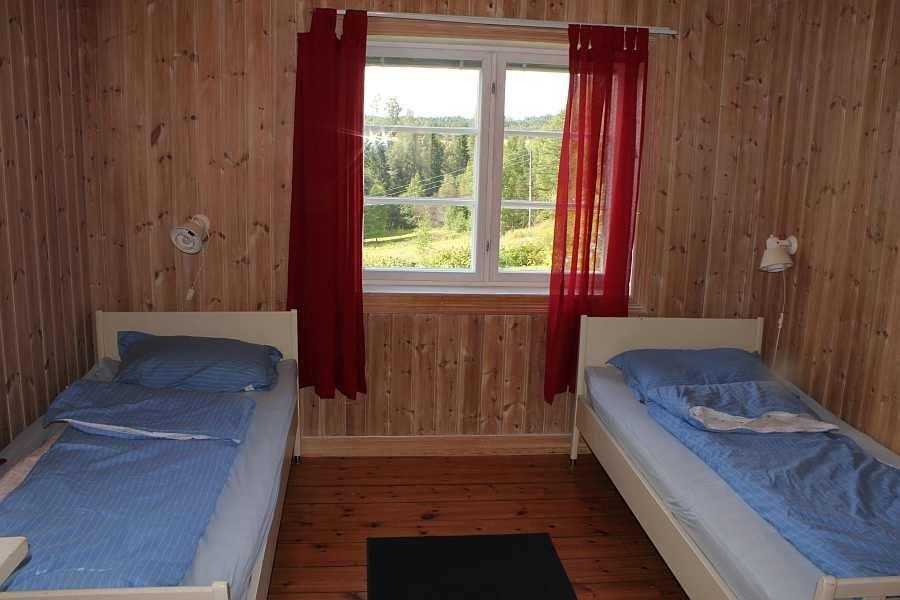 Eines der vier Schlafzimmer - hier mit zwei Einzelbetten
