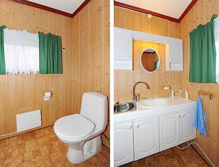 Das zweite der beiden Badezimmer mit WC und Waschbecken