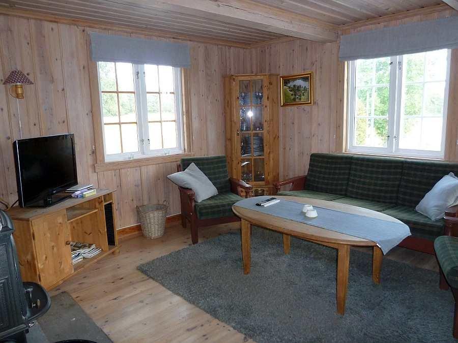 Das Wohnzimmer des Ferienhauses mit Sat-TV
