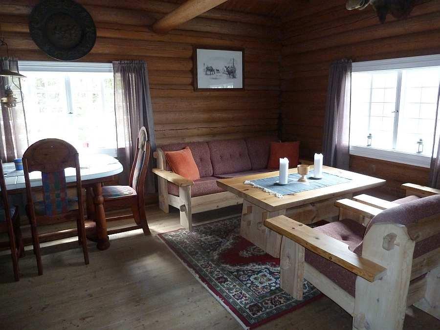 Der Wohnbereich des Ferienhauses - mit Blick auf den See!