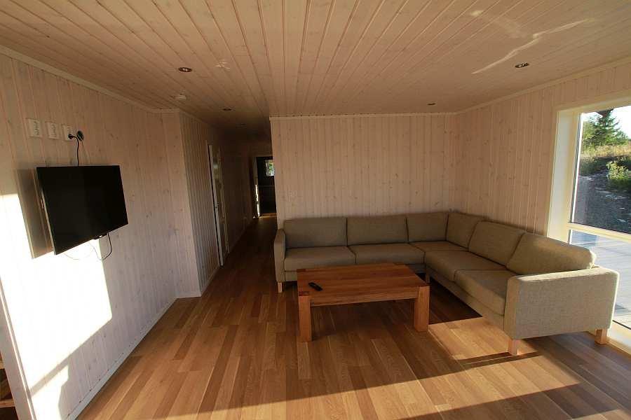 Der Wohnbereich mit Flat-TV