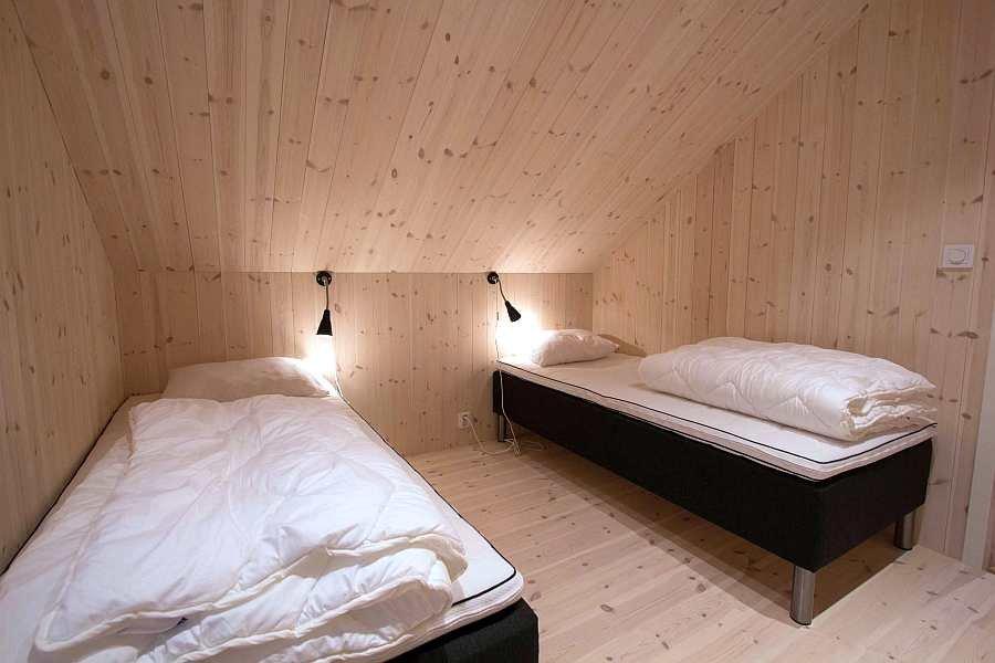 Eines der zwei Schlafzimmer mit jeweils 2 Einzelbetten