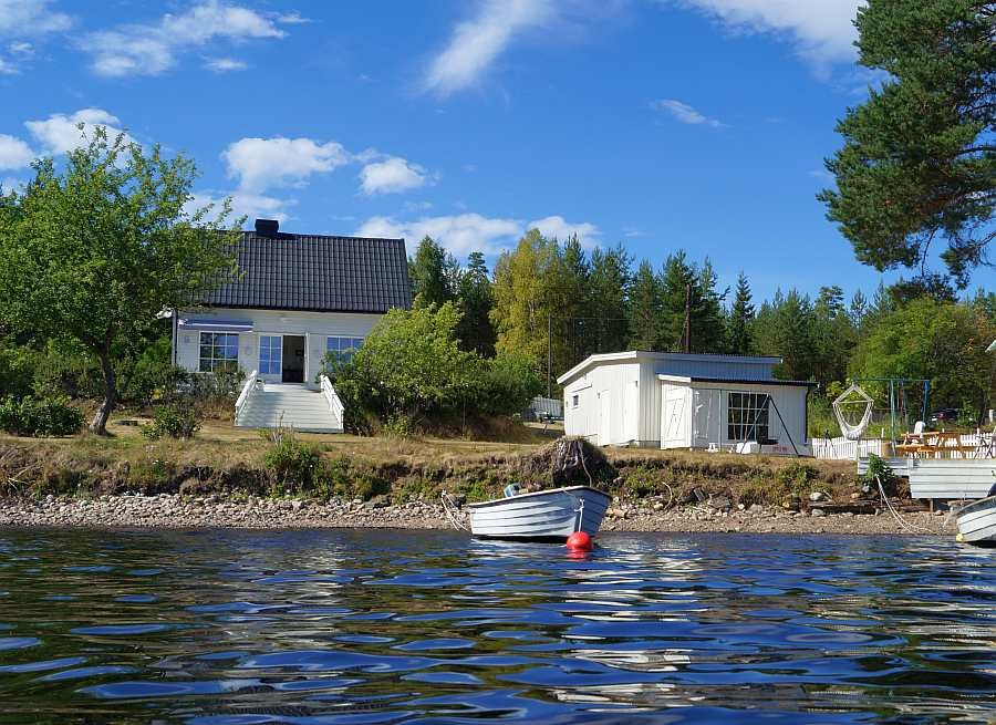 Ferienhaus Nabben direkt liegt direkt am Ufer des Hecht-Sees Bjørknessjøen