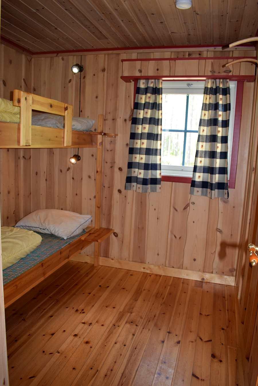 Eines der insgesamt 3 Schlafzimmer mit jeweils einem Etagenbett