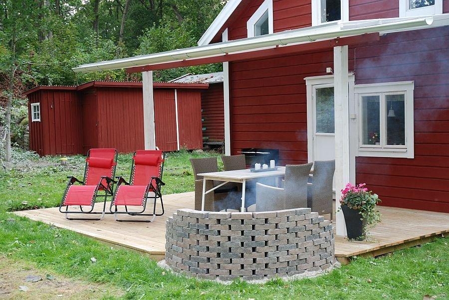 Tolle Veranda mit Grill und Feuerstelle.